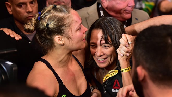 AnnMaria De Mars was on hand to celebrate with Ronda Rousey's win at UFC 190 in August.