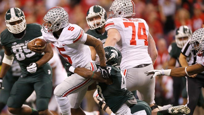 Ed Davis #43 of the Michigan State Spartans brings down Braxton Miller #5 of the Ohio State Buckeyes during the Big 10 Conference Championship Game at Lucas Oil Stadium on December 7, 2013 in Indianapolis, Indiana.