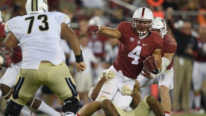 Stanford linebacker Blake Martinez gets tackled after intercepting a pass against Central Florida on Sept. 12, 2015.