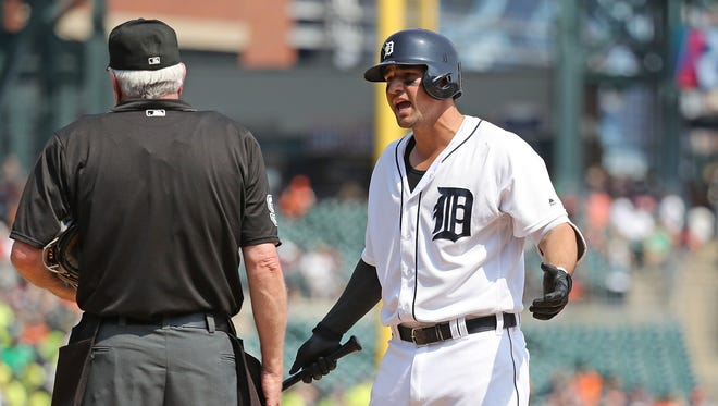Nick Castellanos #9 of the Detroit Tigers argues with home plate umpire Brian Gorman after a called third strike to end the seventh inning of the interleague game against the Philadelphia Phillies on May 25, 2016 at Comerica Park in Detroit.