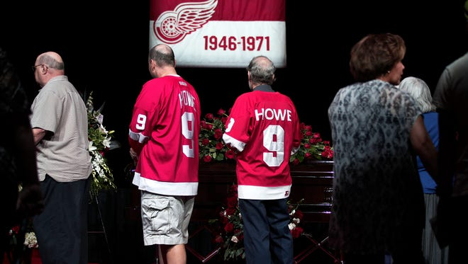 Mourners pay their respects to Hockey Hall of Famer Gordie Howe at his visitation at Joe Louis Arena on June 14, 2016, in Detroit.