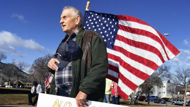 Dale Cochrell of Clinton joins dozens of demonstrators at the steps of the state Capitol in Helena on Feb. 22. A group opposed to granting safe haven to Muslim refugees staged a rally that drew dozens of demonstrators to the Montana Capitol.