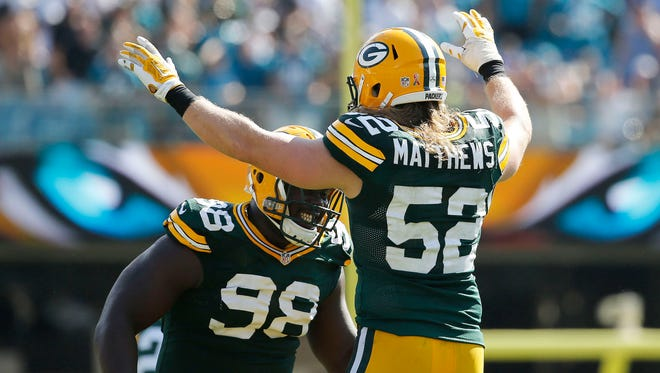 Green Bay Packers defensive lineman Letroy Guion (98) and linebacker Clay Matthews (52) celebrate as they beat the Jacksonville Jaguars at EverBank Field.