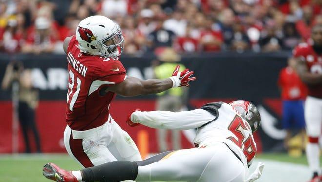 Arizona Cardinals running back David Johnson (31)stiff arms  Tampa Bay Buccaneers middle linebacker Kwon Alexander (58) in their NFL game Sunday, Sept. 18, 2016 in Glendale  Ariz.