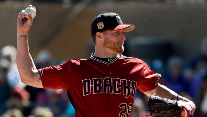 Arizona Diamondbacks starting pitcher Shelby Miller throws against the Colorado Rockies during the first inning of a spring training baseball game in Scottsdale, Ariz., Saturday, Feb. 25, 2017.