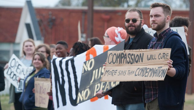 The group Birthplace of Justice holds a No Ban No Wall rally in front of the U.S. Citizenship and Immigration Services offices in Montgomery, Ala., on Thursday March 16, 2017.