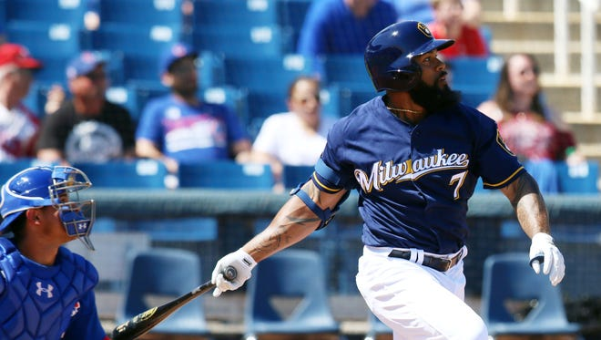 Brewers first baseman Eric Thames hits a single during a spring training game against the Cubs on March 18. Thames is batting .275 in the exhibition season.