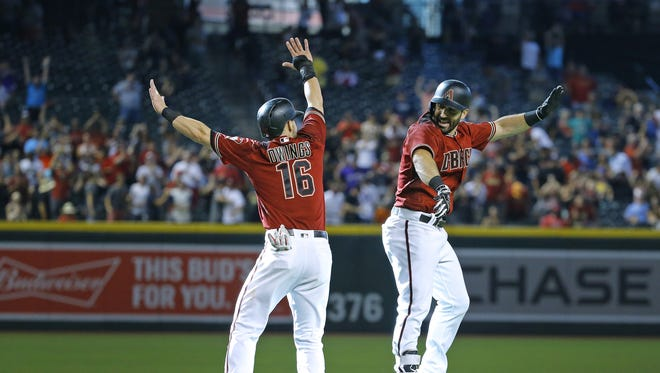 Arizona Diamondbacks' Chris Owings (16) celebrates with Daniel Descalso (3) after his walk off RBI against the Philadelphia Phillies in the 11th inning of their MLB game Sunday, June 25, 2017 in Phoenix, Ariz.