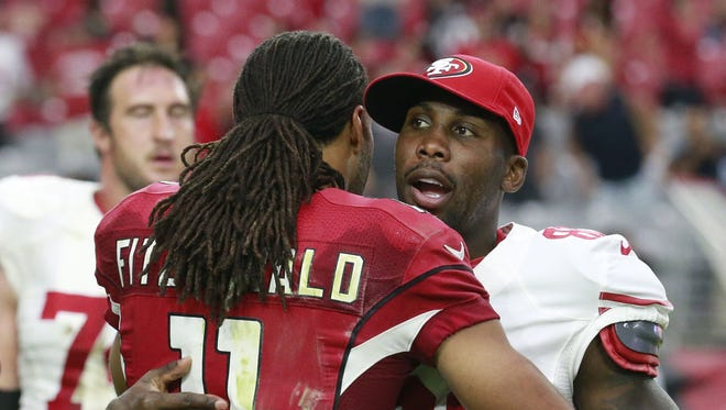Larry Fitzgerald (11) and Anquan Boldin (81) greet following the a 2015 Cardinals win over the 49ers.