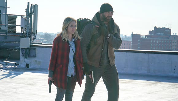 Brittany Snow (left) and Dave Bautista try to stay