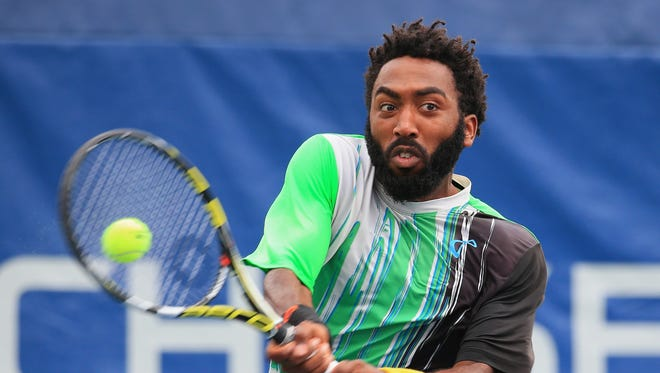 Evan King returns a shot against Michael Mmoh in their men's singles qualifying third round match prior to the start of the 2017 US Open at the USTA Billie Jean King National Tennis Center on Aug. 25, 2017 in New York City.