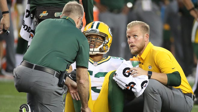 Green Bay Packers outside linebacker Nick Perry (53) talks with the trainers after he was injured during the game against the Denver Broncos on Saturday, August 26, 2017, at Sports Authority Field at Mile High.
