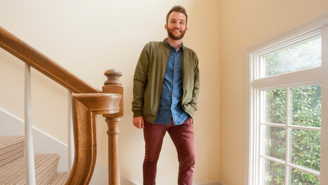 """Stylemaker Davis Jolly wearing his Reell bomber jacket, a """"Your Neighbors"""" denim shirt, slim-fitted chinos from Banana Republic, hiking socks he inherited from his maternal grandfather and Frye leather boots. Realtor Jolly calls this his """"show a house"""" outfit which he says he might alters just slightly to use for social occasions. 19 September 2017"""