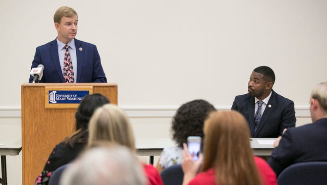 In this Sept. 21, 2017 photo, Republican Bob Thomas, left, and Democrat Joshua Cole, candidates for the 28th District seat in the Virginia House of Delegates, participate in a debate at the University of Mary Washington in Fredericksburg, Va. A federal judge is set to hear arguments Friday, Jan. 5, 2018, in a federal lawsuit challenging the results of a House race after numerous voters were assigned to the wrong district and thus given the wrong ballots. Democrat Joshua Cole lost the Fredericksburg-area seat to Republican Bob Thomas by 73 votes in a race that went to a recount.