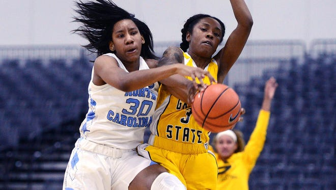 North Carolina Tar Heels forward Jaelynn Murray (30) and Grambling State Lady Tigers guard Takerra Parsons (3) go after the ball during the game at Myrtle Beach Convention Center.