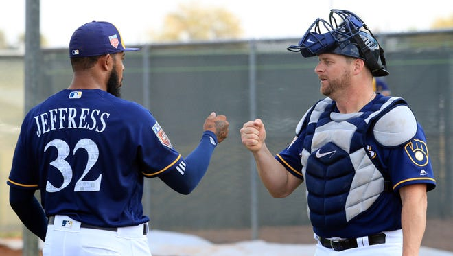 Brewers catcher Stephen Vogt exchanges a fist bump with Jeremy Jeffress.