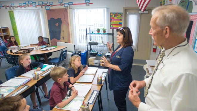 Founder and administrator Frank Lay, right, observes as  third grade teacher Shelley Holzworth conducts her class at the L.E.A.D. Academy in Pace on Tuesday, March 6, 2018.