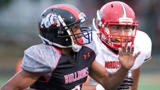 New Albany Bulldogs wide receiver Rondale Moore is off to the races beating Madison Cubs defensive back Nathan Moore.25 Sept 2015
