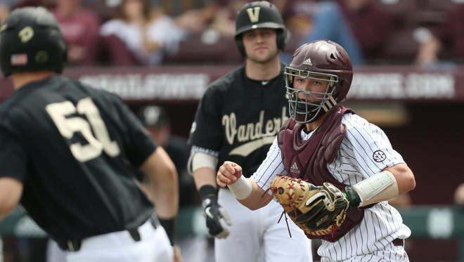 Mississippi State's Dustin Skelton (8) chases down Vanderbilt's JJ Bleday (51) for an out to prevent a run Saturday.