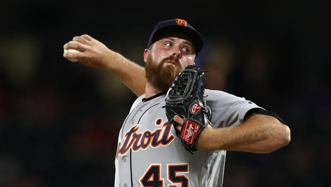 Detroit Tigers reliever Buck Farmer throws a pitch against the Texas Rangers on May 7, 2018 in Arlington, Texas.