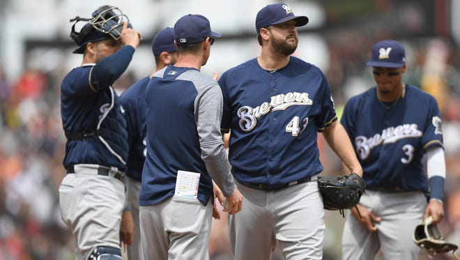 Brewers manager Craig Counsell takes the ball from pitcher Matt Albers in the fifth inning after Albers allowed three runs in relief.