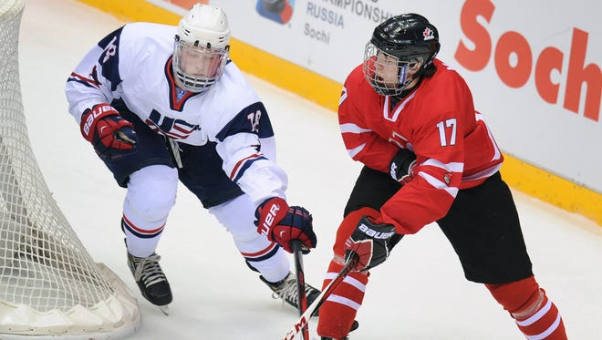 Connor McDavid, right, tries to keep the puck away from Jack Eichel at the world under-18 championships in 2013.