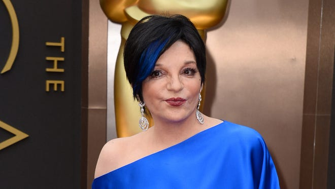 Liza Minnelli arrives at the Oscars in Los Angeles on March 2, 2014.