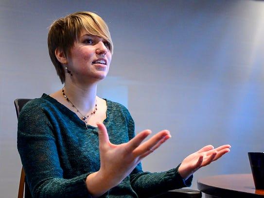 Carla Galaise, a survivor of domestic abuse, speaks