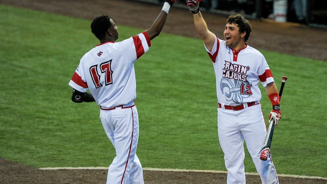 UL outfielder Brian Mills (17), shown here celebrating a home run earlier this season with teammate Brenn Conrad, hit a big grand slam in the Cajuns' 13-9 road win over Georgia Southern.