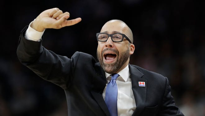 Memphis Grizzlies head coach David Fizdale signals to his players during the first half in Game 2 of a first-round playoff series against the San Antonio Spurs, Monday, April 17, 2017, in San Antonio.