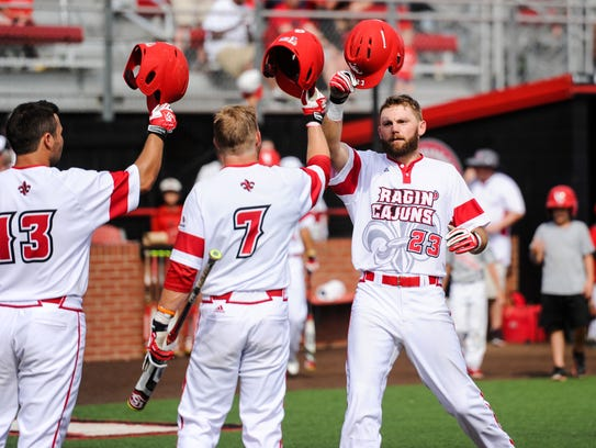 UL's Stefan Trosclair (23) is congratulated after two-run