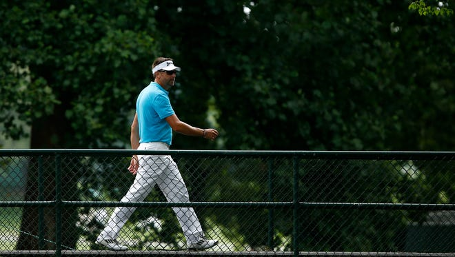 Jun 27, 2013: Robert Allenby walks across the 9th hole bridge during the first round of the AT&T National at Congressional Country Club.