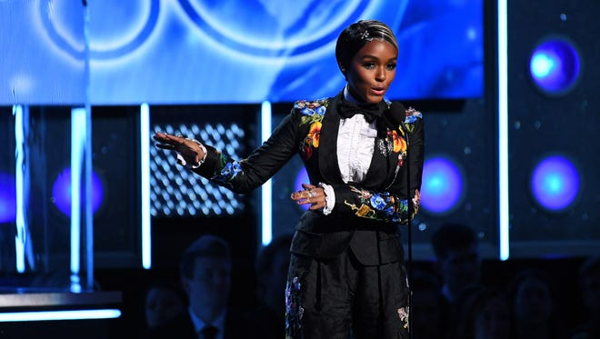Janelle Monae introduces Kesha during the 60th Annual Grammy Awards.