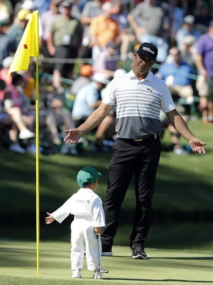 Gary Woodland with his son Jaxson on the 9th green during the 2019 Par 3 Contest at Augusta National Golf Club.