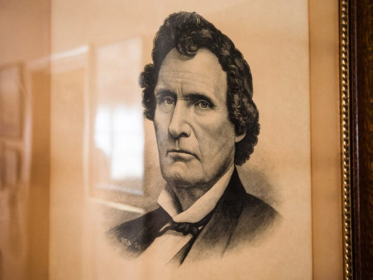 A portrait of Thaddeus Stevens hangs on the wall of