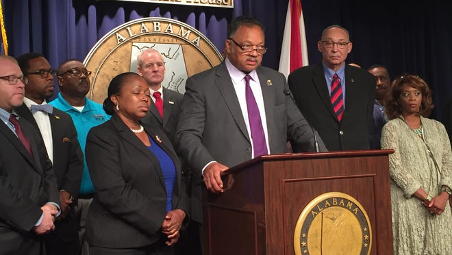 The Rev. Jesse Jackson speaks at a press conference at the Alabama State House on Oct. 7, 2015. Rep. Louise Alexander, D-Bessemer, stands to the left of Jackson; Rep. Thad McClammy, D-Montgomery, stands to his right.