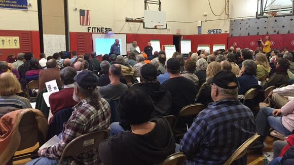 Controversy over the Black Oak Wind Farm spurred about 150 people to fill the gymnasium at Enfield Elementary School and voice their concerns or support for the project.