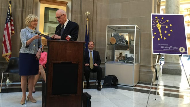 Indiana Bicentennial Commission co-chairman and former Congressman Lee Hamilton presents the 155-page Bicentennial Visioning Project to commission co-chairwoman and former Lt. Gov. Becky Skillman and