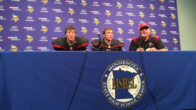 Pierz football players Brett Kapsner and Lane Girtz and head coach Leo Pohkamp answer questions at Saturday's press conference. The Pioneers lost 35-28 to St. Croix Lutheran at U.S. Bank Stadium.