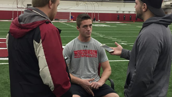 UW recruit Jack Coan talks to reporters on signing day in Madison.