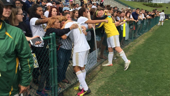 Merritt Island fans console players after Saturday's Class 3A final in DeLand.