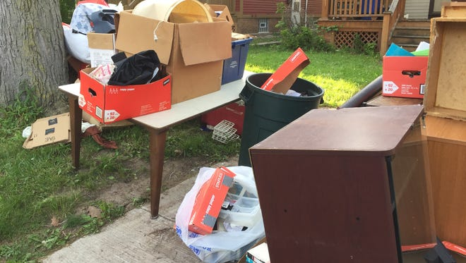 Residents of a 19th Ward house brought trash to the curb days ahead of the scheduled pickup.