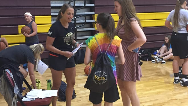 New Licking Heights coach Rebecca Bailey welcomes a participant Monday to the program's youth camp.