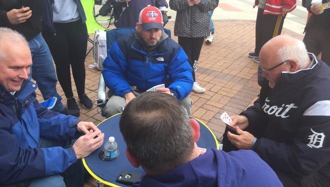 New Tigers manager Ron Gardenhire, on the right, played cards with fans Saturday morning who were lined up to attend TigerFest at Comerica Park.