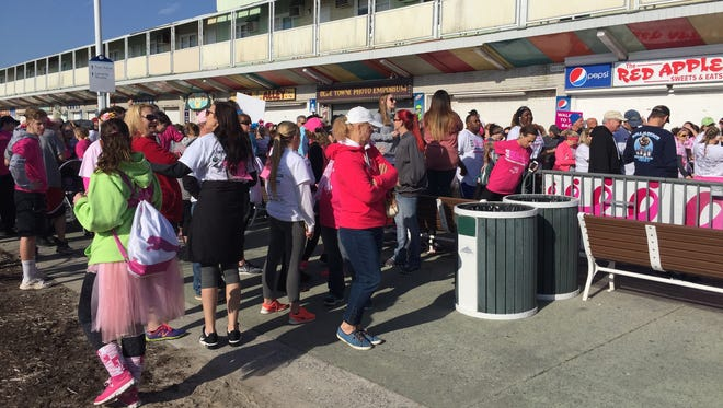 Runners prepping at the 7th Annual Susan G. Komen Race for the Cure in Ocean City on April 14, 2018. Event organizers estimate over 2,000 people showed up.