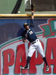 Brewers left fielder Khris Davis can't catch a home run hit by Los Angeles Dodgers catcher Yasmani Grandal at Miller Park.