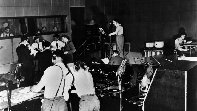 Orson Welles, center, rehearsing for the Oct. 30, 1938, broadcast of 'War of the Worlds.'
