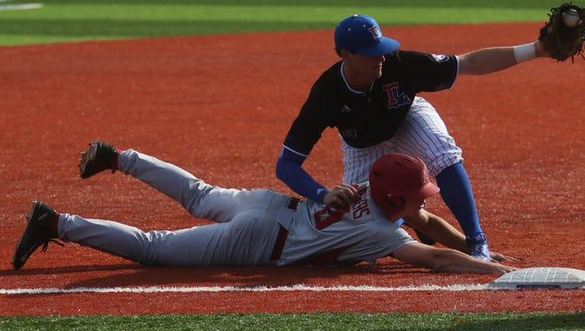 Louisiana Tech's Chase Lunceford stops Arkansas' Jax Biggers from making it to third base during the Razorbacks' second game against the Bulldogs at J.C. Love Field in Ruston on Wednesday, March 1, 2017. The Razorbacks won 13-10.