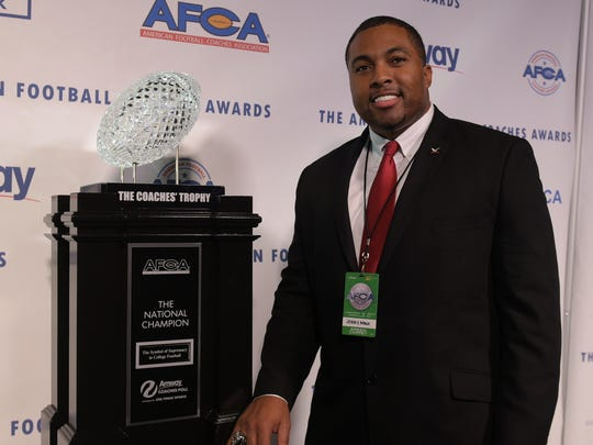 North Carolina Central Head Coach Jerry Mack poses with the Coaches Trophy presented by Amway on the green carpet at the 2017 American Football Coaches Awards at the Grand Ole Opry in Nashville, Tenn., Tuesday, Jan. 10, 2017.