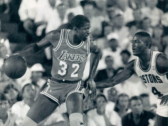 The Pistons' Joe Dumars guarding the Lakers' Magic